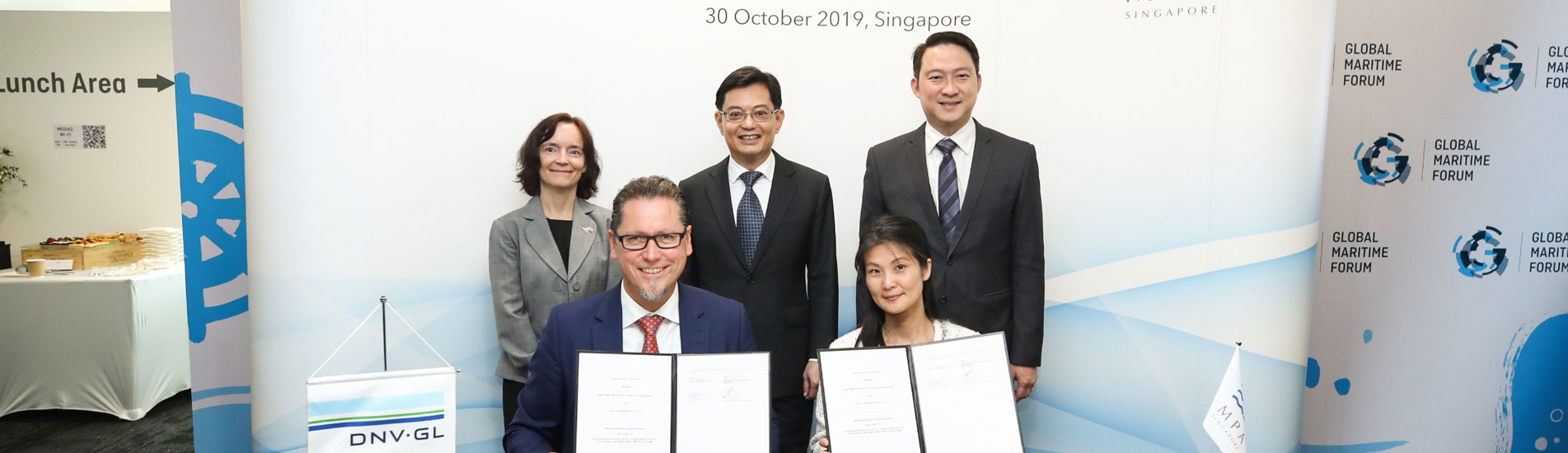 Signing the MoU (front): Ms. Quah Ley Hoon, Chief Executive, MPA, and Remi Eriksen, Group President & CEO, DNV GL. (Back, left to right): Her Excellence Anita Nergaard, Norway's Ambassador to Singapore; Mr. Heng Swee Keat, Deputy Prime Minister of Singapore and Minister for Finance, and Dr. Lam Pin Min, Senior Minister of State of Singapore