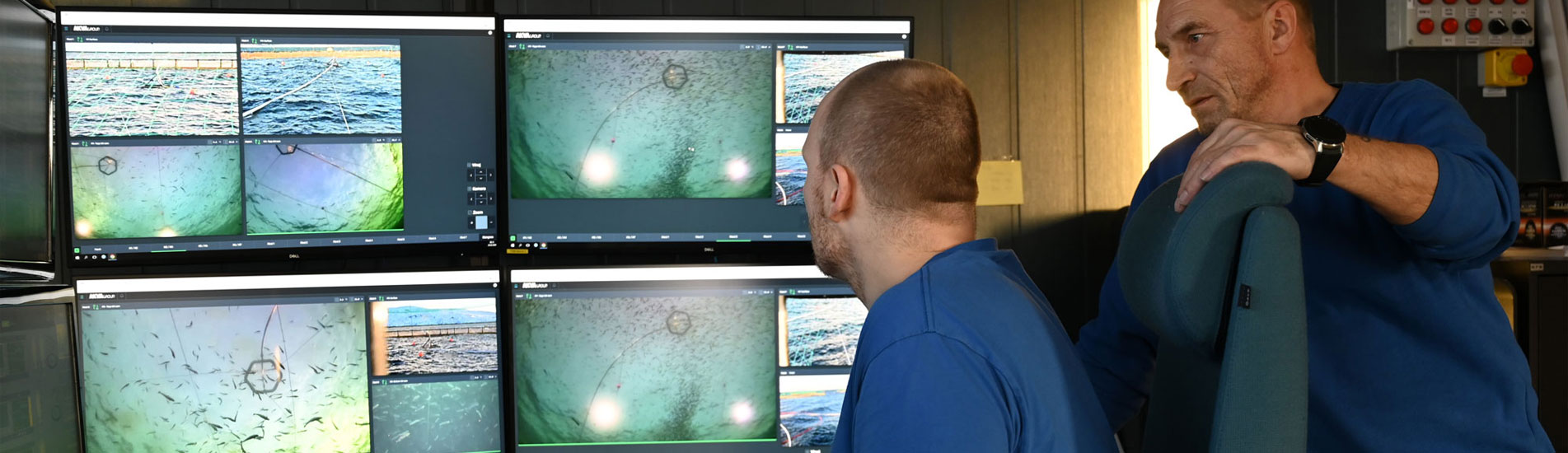 FULL CONTROL: Fish farmer Lars André Johnsen (left) and Operating Manager Michael Olsen studies the video images of fish being fed through the control system AKVAconnect 4.1.